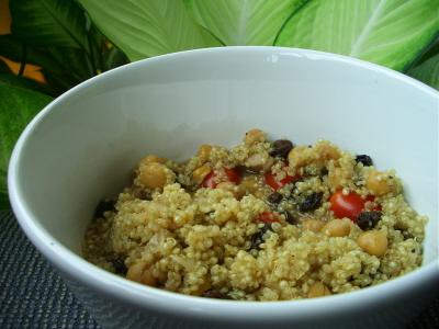 Quinoa chicken corn broth with plum tomatos chick peas raisins and fenugreek chicken